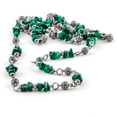 Medium long necklace made with beautiful green malachite gemstone chips and antiqued silver elements. Great combination of colors and textures. Sold.