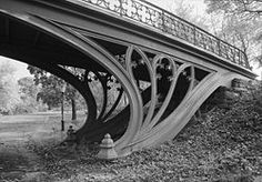 Cast-iron Gothic tracery supports a bridge by Calvert Vaux, Central Park, New York City.