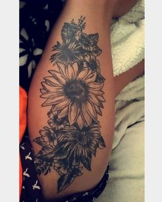 Black and gray - sunflowers & lilies or dahlias