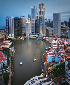 Boat Quay, the largest of the three historic quays along the Singapore River, boasts plenty of alfresco riverfront cafes and bars, which make it a popular hangout for locals and tourists alike... by williamcho, via Flickr