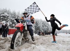 A motorcyclist passing a flag bearer during a race in a snow covered forest close to Radashkovichi, some 55 km north of Minsk on Feb. 9. (Victor Drachev/AFP/Getty Images) - See more at: http://www.boston.com/bigpicture/2013/03/daily_life_february_2013.html#sthash.TQLBRP3S.dpuf
