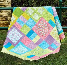 Fanciful, by TaylorMade by Design, is a twin, bed-size quilt perfect for girly girls! Bright pink, blue, yellow, purple, and green prints in a fun, graphic setting make this bed-size quilt one she'll love for her room or to take on sleepovers.
