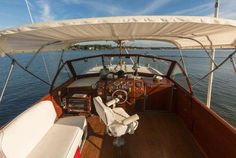 View from the captain's chair, or behind it, on a vintage wood boat, a classic. Power Boats For Sale, Used Boat For Sale, Cool Boats, Used Boats, Boat Financing, Chris Craft Boats, Boat Dealer, Classic Wooden Boats, Fresh Water Tank