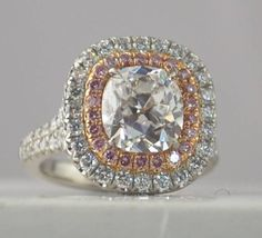 WOW!! Our newest most magnificent ring ever!! 2.18 Center Cushion Cut (F color) surrounded by PINK DIAMONDS and another row of white diamonds, AND pink and white diamonds underneath.