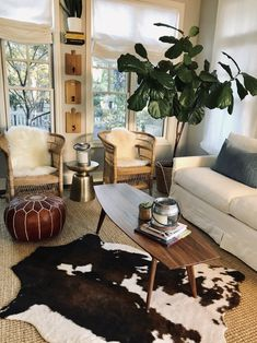 Get inspired by Eclectic Living Room Design photo by Wayfair. Wayfair lets you find the designer products in the photo and get ideas from thousands of other Eclectic Living Room Design photos. Eclectic Living Room, Boho Living Room, Living Room Designs, Living Room Modern, Living Room Decor, Bedroom Decor, Cow Hide Rug Living Room, Cowhide Rug Decor, Faux Cowhide Rug