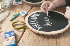 Chalk board paint on wooden tree rounds. And other DIY Ideas for Christmas wall gallery