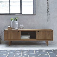 Tikamoon, presents a collection of TV stands in teak, bamboo, mahogany. Feature Wall Design, Solid Wood Tv Stand, Solid Wood Furniture, Tv Unit, Contemporary Furniture, Scandinavian Design, Living Room Furniture, Room Decor