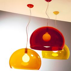 Semi transparent coloured pendant lamp from Kartell. The FL/Y pendant lamp is an essential lamp which is characterised by the subtle transparent methacrylate lampshade which is available in all the colours of the rainbow. The cover is cut off underneath the height of the diameter to give an unusual effect and collect most of the light. The sheen and colour of the fitting bring to mind a sopa bubble, iridescent with reflections of light. Hang individually or group together to form interesting…