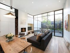 YES please!! Love the glass wall with the black frames, the big bench and the wooden floor