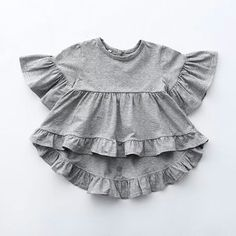Leah ~ Grey Frill Tee (toddler) A boho frill top made from a luxe cotton. We have it for mommy & dolly! See the Mommy & Me section for the Mommy sizes. Baby Girl Dresses, Baby Outfits, Baby Dress, Cute Dresses, Kids Outfits, Stylish Outfits, Baby Girl Fashion, Toddler Fashion, Kids Fashion