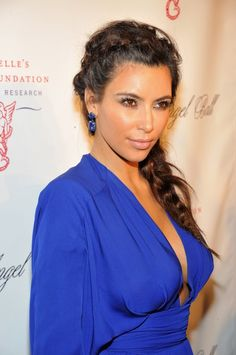 Kim Kardashian and Kanye West Attend Angel Ball in NYC in Blue Dress  --gorgeous hunger games hair, and pretty natural makeup