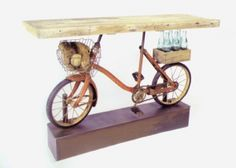 Eclectic repurposed bicycle table.  http://thebenjamincollection.wordpress.com/2012/04/05/eclectic-repurposed-bicycle-table/