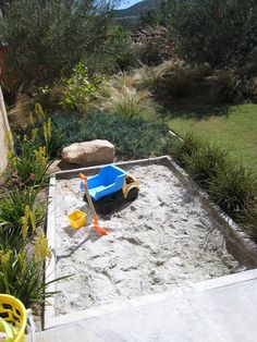 Camouflage the sandbox. Sand provides a potentially soothing sensory experience and stretches the imagination. Nestling a sandbox within a p...