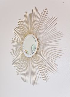 DIY Starburst Mirror  http://thirdfloordesignstudio.blogspot.com/2011/02/tuesday-tip-diy-sunburst-mirror.html