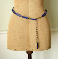 Vintage 1960s mod chain belt made of blue plastic links and gold tone chain. Label: -    Condition:    Excellent    Measurements:    adjustable length of 33 to 39
