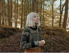 Note the environment and facial expression. The princess has a fearful but curious relationship with nature. Despite her pale white skin and hair, she seems​ like a natural part of the forest scenery. Aurora Aksnes, Stavanger, People Photography, Amazing Photography, Nature Photography, Landscape Photography, Scenic Photography, Night Photography, Landscape Photos