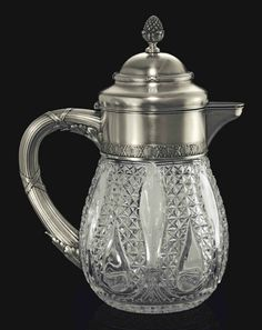 A Silver-Mounted Cut-Glass Jug (Marked K Faberge with the Imperial warrant, Moscow, 1908-1917) (33 cm high)