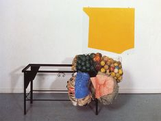 Jessica Stockholder - Untitled 1990 Metal table, glass, enamel paint, newspapers, tennis balls, 2 parts: 82 x 92 cm