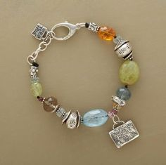 "STRONG SPIRIT BRACELET -- Handmade by Jes MaHarry, these sterling silver charms are etched with a wise oak and the words ""be true"" and ""strong."" Around them a sparkling array of gems: aquamarine, smoky quartz, green garnet, citrine and pink tourmaline. Made in USA. 7-1/4"" to 8-1/4""L."