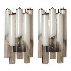 Pair of 1970's Italian Glass Tube Sconces | From a unique collection of antique and modern wall lights and sconces at https://www.1stdibs.com/furniture/lighting/sconces-wall-lights/