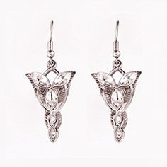 Gorgeous sparkling silver tone Arwen's Evenstar Lord of the Rings inspired dainty drop earrings, set with faux clear crystals. Very pretty. On silver tone earring hooks. Measures approx x Metal alloy. Pendant Earrings, Silver Earrings, Drop Earrings, Lord Of The Rings, Lotr, Clear Crystal, Costume Jewelry, Belly Button Rings, Crystals
