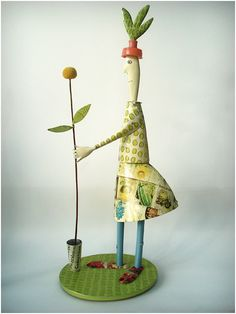 Woman with Flower - By artists Mike Abbott and Kim Ellwood - www.abbottandellwood.com -images are printed onto metal and found objects to tell a new story, creating objects with humour and pathos.