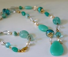 Vogue Crafts & Designs Pvt. Ltd. manufactures Light Green Stones Silver Necklace at wholesale price.