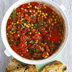 Chorizo & Chickpea Stew Recipe Main Dishes with chorizo sausage, purple onion, garlic cloves, smoked paprika, cumin seed, cherry tomatoes, lemon, chickpeas, flat leaf parsley, sourdough bread