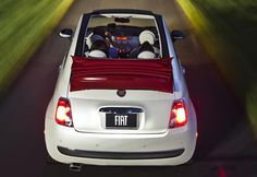 This is my dream car.....cream colored convertible Fiat with tan leather interior. Red top.