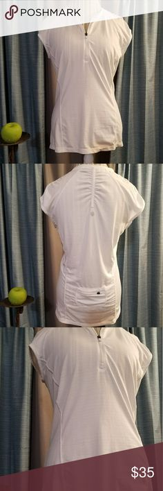 🌻🌺🌻ATHLETA ZIP DOWN V NECK SHIRT!! SIZE:large   BRAND:Athleta   CONDITION:like new, please refer to pic of logo on the back as there is a super TINY snag you can barely see but did want to point out   COLOR:white  Has little pocket in the back and rouched sleeves and back. Any streaks are from lighting.   🌟POSH AMBASSADOR, BUY WITH CONFIDENCE!   🌟CHECK OUT MY OTHER ITEMS TO BUNDLE AND SAVE ON SHIPPING!   🌟OFFERS WELCOME!   🌟FAST SHIPPING! Athleta Tops