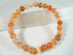 Orange Botswana Agate Stretch Bracelet 6mm Smooth Round Polished Gemstone Beads by SandiLaneFineArt on Etsy