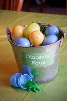 "Speckle Easter eggs with spray paint to make Dino eggs. Give each guest one on arrival. Have each contain candy and a few contain a ""you've won a raffle"" for a special door prize."