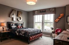 Cute idea for Ty's room...Maroon & White of course ATM  Metal Numbers and lamp