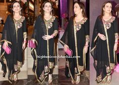 Nita Ambani In black Abu Sandeep churidaar suit with pink and gold accents At The 'Pinkfilly' Breast Cancer Awareness Fundraiser