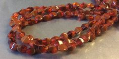 Czech Pinch Bead 5mm X 3mm Transparent Orange and Opaque Red Brown Mix 1 Strand by gypsybeadpeddler on Etsy