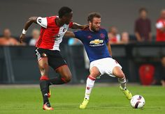 Juan Mata of Manchester United is put under pressure by Terence Kongolo of…