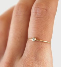 Gold Diamond Stacking Ring | Simple yet elegant, this diamond ring features a brilliant whi... | Rings