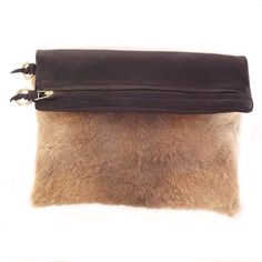 This oversized clutch is so luxurious with the softest leather and fur