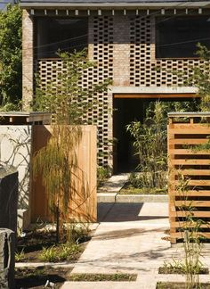 Mews House by TAKA Architects - brick and wood to filter light