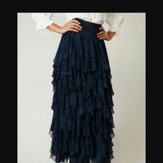 Free People 5 layer full length skirt, NWOT Beautiful, flowy, exactly as pictured, only better! Zip back. White image to show detail. This is an amazing piece and you will not be sorry if you buy it, I promise:) Sold out everywhere, and rare to find- even used, especially a medium sized black version. This was never ever worn, so it is brand new, just no tags. Free People Skirts Maxi