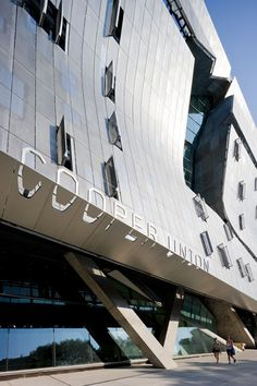 Optically extruded letterforms on the facade of the new Cooper Union building, New york. Environmental graphics by Pentagram.