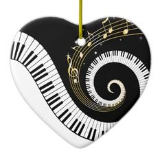 Unusual musical design featuring swirling piano keys with gold musical notes flowing from the centre of the keys. This design would make the perfect gift for the piano lover and is available on a collection of gifts and paper products.