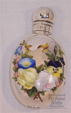 Sterling Victorian Bottle - When the smallest things were embellished.like crazy,  Sterling silver and enamel - Designer/Maker, Sampson Mordan - English hallmarks - Date or Era:1888-1889 - Dimensions:2-3/4 in. x 1-1/2 in. - Fine multicolored enameling over silver
