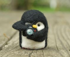 Needle Felted Penguin - Holding Camera by scratchcraft on Etsy https://www.etsy.com/listing/181980354/needle-felted-penguin-holding-camera