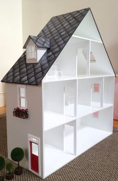 Gorgeous A frame doll house for girls, painted in a pale taupe, with charcoal slate roof detail as shown. This particular doll house is in an A frame style, which is ideal as a dollhouse for younger girls. A doll house can provide hours and hours of fun and creative play, for
