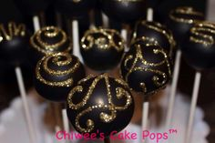 Black and gold swirl cake pops