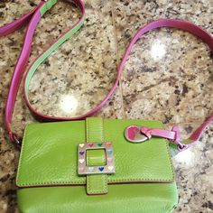 Dooney & Bourke Lime Green and Pink Purse Small with multicolored heart accents. Long adjustable shoulder strap. Has some fading on back of purse.  Price reflects this. Dooney & Bourke Bags Mini Bags