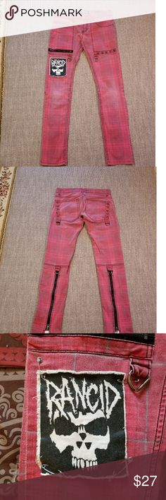 """Lip Service Rude punk jeans Red and gray plaid with studs on the pockets. Loops to attach chains and belts Rancid patch on right leg. 99 % cotton 1 % spandex Waist 28 Rise 7"""" Length 30 """" 14"""" zippers on the back of the calves. 3 button fly. Good condition Lip Service Jeans Skinny"""