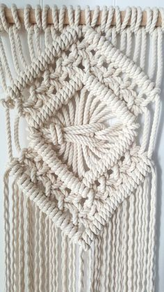 Classic macrame with a twist...  Made with 8mm rope this peice is chunky.  #Dimensions#  From top to bottom of supporting fringe- 99cm  Width of macrame- 32cm  Width of supporting dowel- 60cm