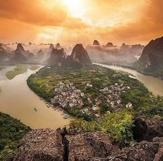A View to Die For' Standing on top of a 1000ft karst peak overlooking the stunning vistas of Guangxi province, Xingping, China.